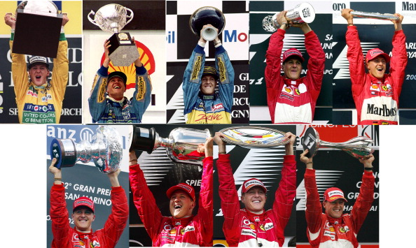 (FILES) This combo shows German driver Michael Schumacher holding his trophy after winnning several F1 Grand Prix on (L-R) August 30, 1992, March 24, 1994, July 02,1995, September 24, 2000, August 19, 2001, April 14, 2002, May 18, 2003, March 07, 2004 and October 01, 2006 . Seven-time world champion Michael Schumacher confirmed on October 4, 2012 that he will retire for the second time at the end of 2012. AFP PHOTO        (Photo credit should read -/AFP/GettyImages)