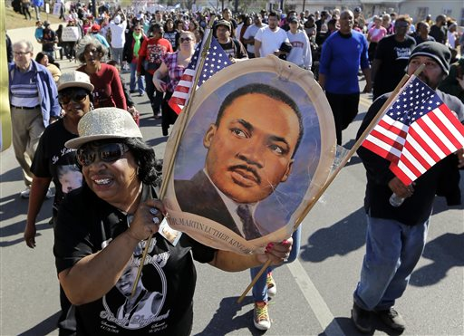 Robbie Thompson participates in a march honoring Martin Luther King Jr., Monday,  Jan. 20, 2014, in San Antonio.  Parades and celebrations have been scheduled across Texas to honor Martin Luther King Jr. on the federal holiday in his name. (AP Photo/Eric Gay)