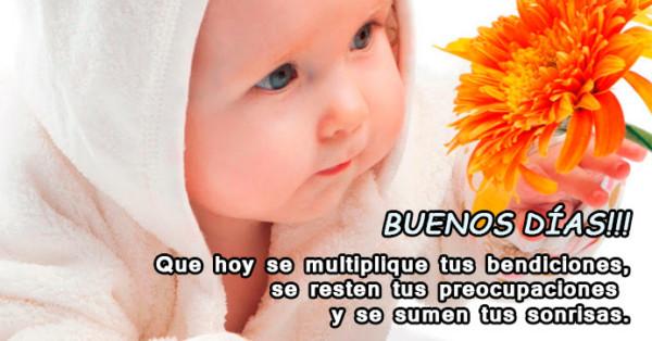 Imagen de bebé con una flor y frase de buenos días http://fechaespecial.com/