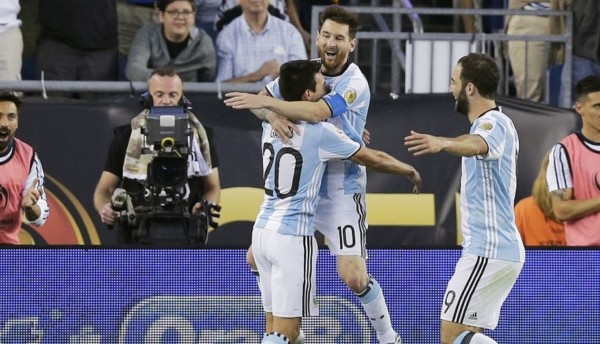 Argentina's Lionel Messi, center, celebrates his goal against Venezuela with Nicolas Gaita, left, and Gonzalo Higuain during the second half of a Copa America Centenario quarterfinal soccer match Saturday, June 18, 2016, in Foxborough, Mass. (AP Photo/Charles Krupa)