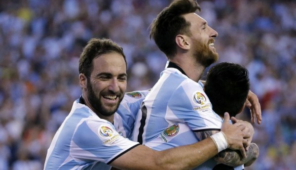 Argentina's Lionel Messi, center, celebrates his goal against Venezuela with Gonzalo Higuain, left, and Nicolas Gaitan during the second half of a Copa America Centenario quarterfinal soccer match Saturday, June 18, 2016, in Foxborough, Mass. (AP Photo/Elise Amendola)